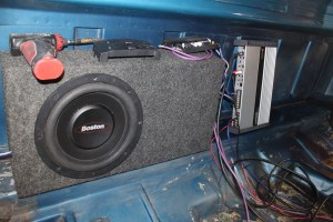 11.The Boston audio gear was wired up and test fit behind the seat. The amp will mount to the rear wall; all the wires will be neatly hidden under the carpet.