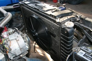 """This electric fan has been installed without a shroud. This system does not cool the engine at all, there is simply too much uncovered radiator space and not enough air flow. This radiator should have a pair of 12"""" or 14"""" fans with a shroud."""