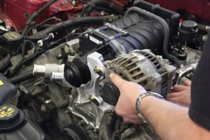 19. The alternator bracket and alternator were installed next. This places the alternator quite high in the engine bay, but it still clears the stock hood.