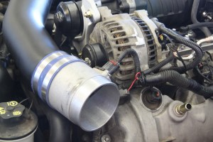 24. The car already had a 97mm air cleaner tube, so we reused it. The Roush air tunnel has a mount for the MAF sensor, but it also comes with a plug, which we installed.