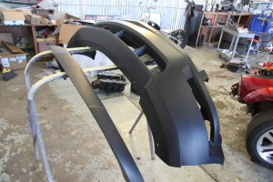 12.The chin spoiler was the easiest of all the mods we made. This piece adds an aggressive note to the factory bumper cover. The bulk of the spoiler is held in place with double-sided tape.
