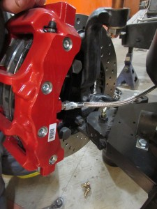 15.Next, the other end of the line was attached to the caliper. We repeated these steps for the driver's side brakes.