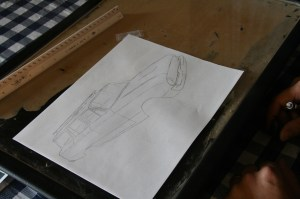 Kyle traced the fine lines of the wagon. Anything you want to eliminate, like door handles, grille feature, etc should be left out. This line drawing is omits the grille, emblems, door handles and wheels.