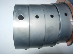 """9.Stock main bearings have 3/16"""" oil holes. Jim drills these to 5/16"""" to match the drilled block passage."""