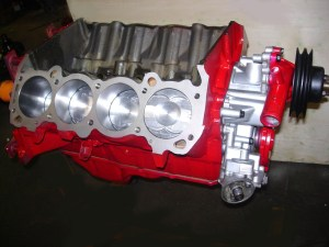 31.All done, the short block is complete. The Sealed Power Hypereutectic pistons from Poston Buick are a welcomed addition in place of the stock dished-out 8.5:1 slugs.