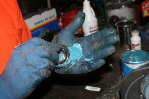 22.The bearings for the front rotors were packed with grease and installed in the rotors.