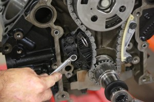 21. We replaced the original timing gear guide with the MOPAR factory upgrade, which uses a Teflon guide pad instead of just raw plastic.