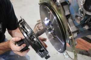14. We used the old input shaft to line up the clutch to the flywheel. The little plastic one works too.