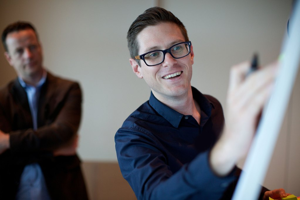 Pictured is a professional man giving a presentation - Credit Sebastiaan ter Burg