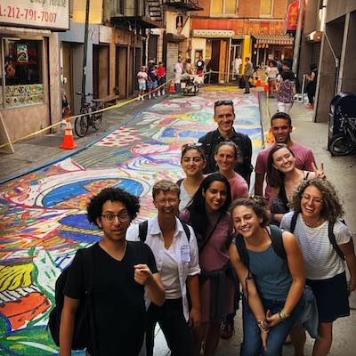 Immigrant New York Tour with group on Doyer Street in Chinatown