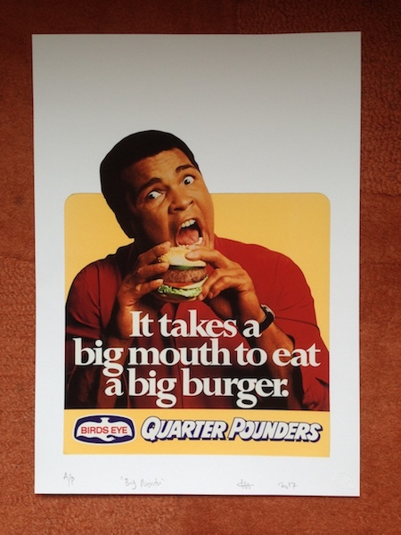 Muhammad Ali eating a hamburger