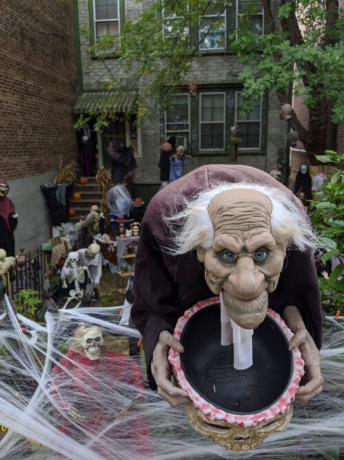 Row house decorated with gremlins for Halloween, a popular holiday. Celebrated to the fullest in New York.