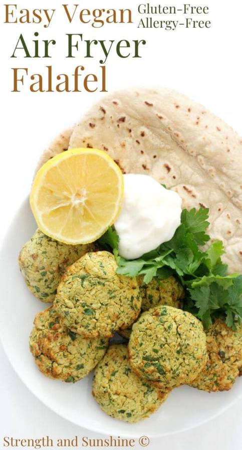 finished plate of healthy air fryer falafel with pita and lemon image text