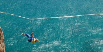 unrecognizable woman hanging over sea