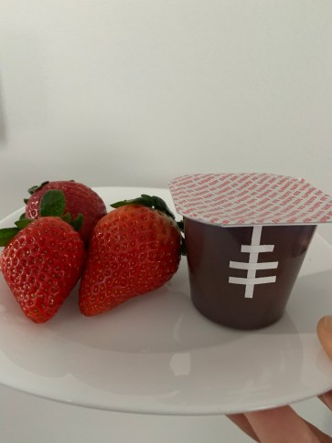 Strawberries and Chocolate pudding that look like footballs