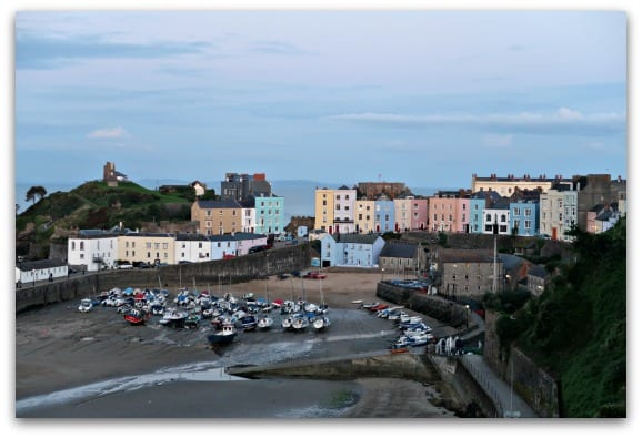 The harbour in Tenby with the colourful backdrop of the pastel coloured houses