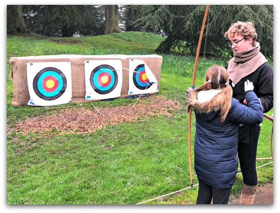 Children and adults can have a go at rchery at Warwick Castle