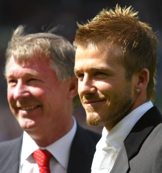 Manchester United's David Beckham (R) stands with manager Sir Alex Ferguson before their match against Charlton Athletic in the English premier league match at Old Trafford ,Manchester, May 11, 2002. Beckham has signed a new three year deal with Manchester United worth 90,000 pounds ($131,600) per week, making him the world's highest-paid footballer, following a year of negotiations with the Old Trafford club. width=