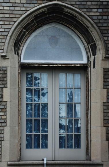 Art Gallery Reflected in School of the Arts window