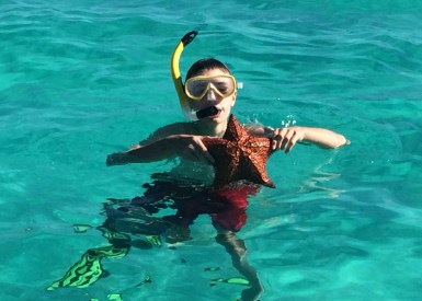 Owen and starfish: Tobago Cays