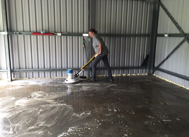 Grunt work - using the scrubber (without power!) - basically just a big heavy round broom lol.