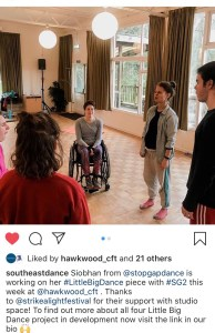 """A screenshot of an Instagram post. The picture is of five people in a rehearsal space. On person is in a wheelchair, the others stand. Below is the caption """"southeastdance: Siobhan from @stopgapdance is working on her #LittleBigDance piece with #SG2 this week at @hawkwood_cft. Thanks to @strikealightfestival for their support with studio space! To find out more about all four Little Big Dance project in development now visit the link in our bio (raised hands emoji)""""."""
