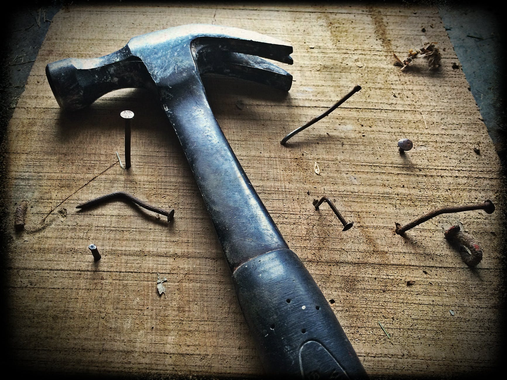 black claw hammer on brown wooden plank