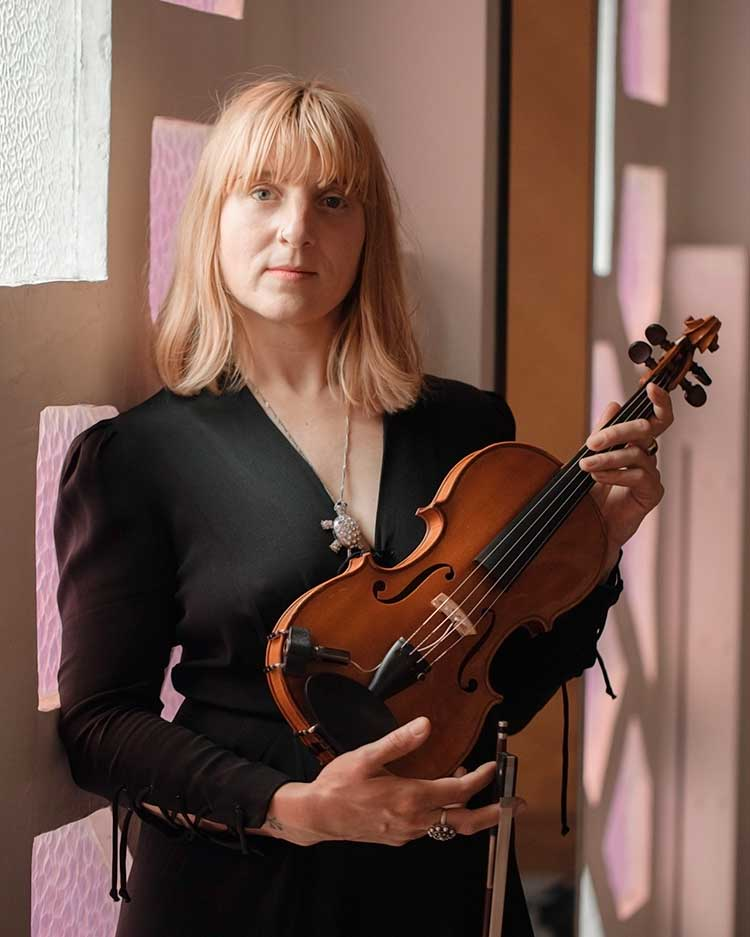 Agathe Max holding violin and bow