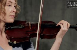 common bowing problems demonstrated by a woman holding a violin