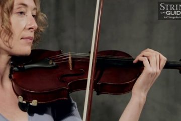 common bowing problems - woman holding violin