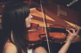 playing violin in tune