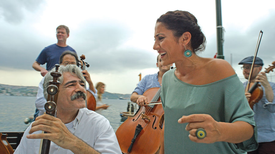 Kayhan Kalhor, of the Silk Road Ensemble, is playing the kamancheh, an Iranian spike fiddle. He's pictured with Kurdish singer Aynur Dogan in 'The Music of Strangers.'