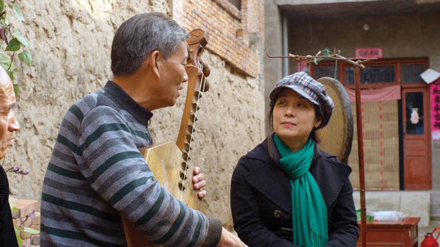 Wu Man of the Silk Road Ensemble and Zhang Ximin in 'The Music of Strangers.'
