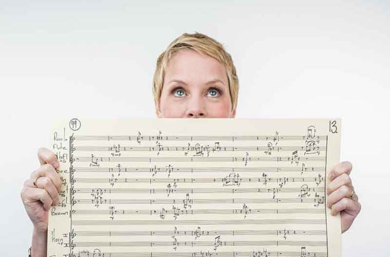 Composer Augusta Read Thomas holds sheet music