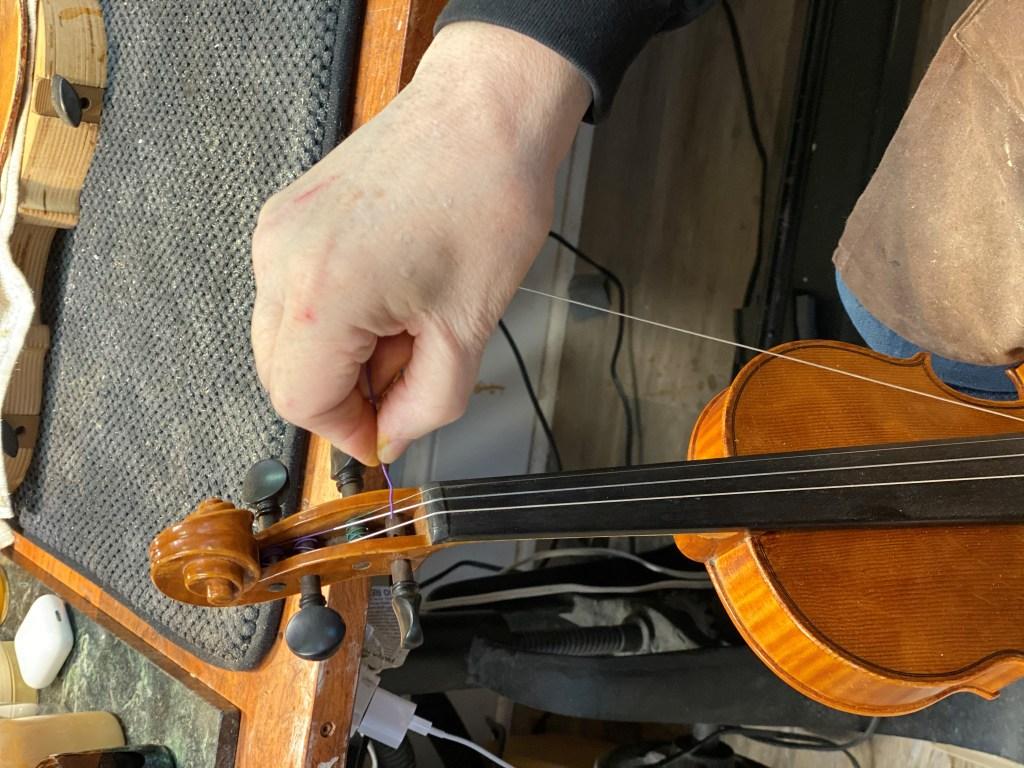 Restring violin