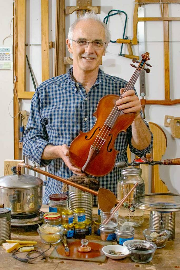 Andrew Carruthers with Redwood Violin and some of the materials used to build it.