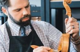 Ryan McLaughlin working on a violin