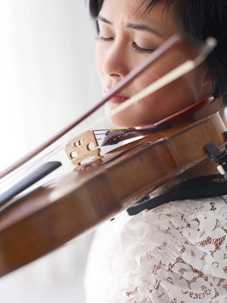 Violinist Jennifer Koh bowing a violin