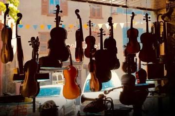 violins hanging in a shop window