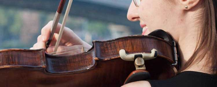 woman playing violin with a shoulder rest