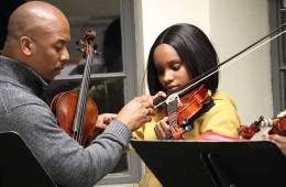 Quinton Morris works with a student from the Key to Change Studio, South King County, Washington