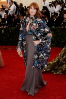Florence Welch wears out-there things like this often, so you'd think she'd either learn or it would grow endearing.. But I'm just not a fan of things that are too busy like the top part of this dress. { Valentino Couture }