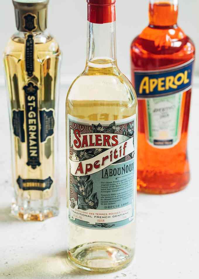 bottles of st. germain, salers aperitif, and aperol