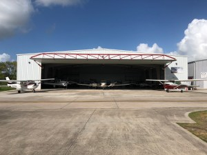 Coastal Skies Flying Club Hangar at Pearland Regional Airport | Stripes to Bars