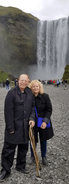 Photo of Paul and Stephanie at a waterfall in Iceland, 2019