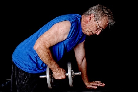 senior man doing dumbbell row