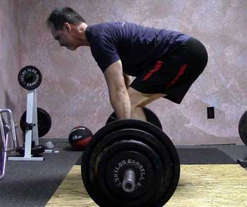 Preparing to deadlift a barbell