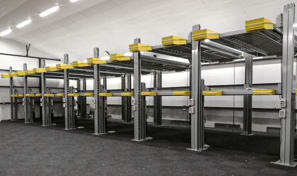 Row of grey and yellow car lifts