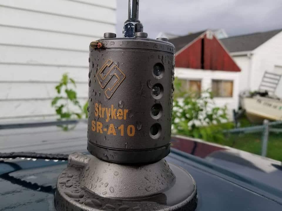 SR-A10 magnetic mount antenna on a car roof-top on a rainy day with a bug on it.
