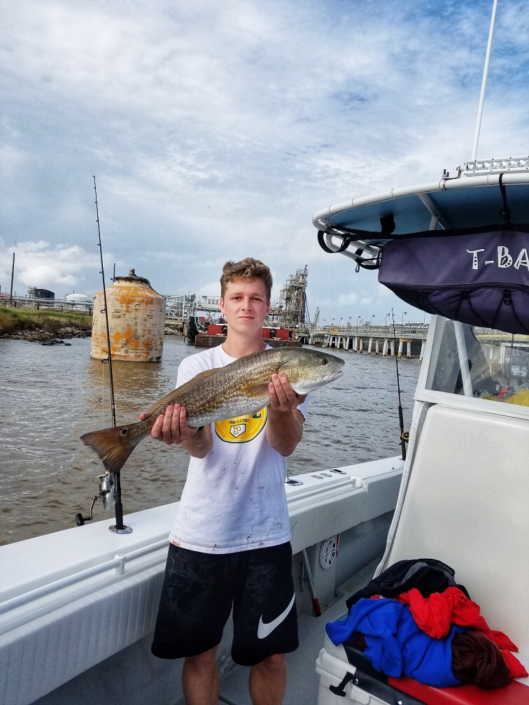 smiling-young-kid-redfish-charter-2018